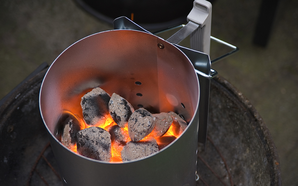Coals turn ashy white signifying that they are hot enough to grill.