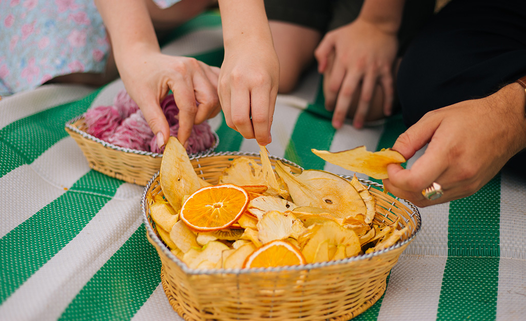 Family enjoying dried orange slices, apply rings and other fruit snacks.