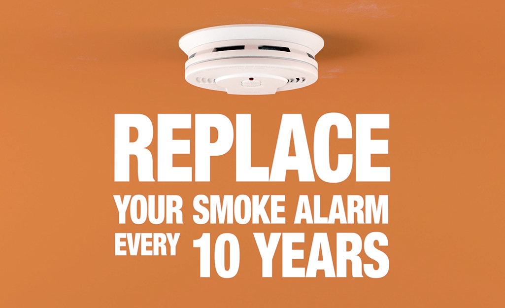 "An image of a ceiling smoke alarm that reads, ""Replace your smoke alarm every ten years."""