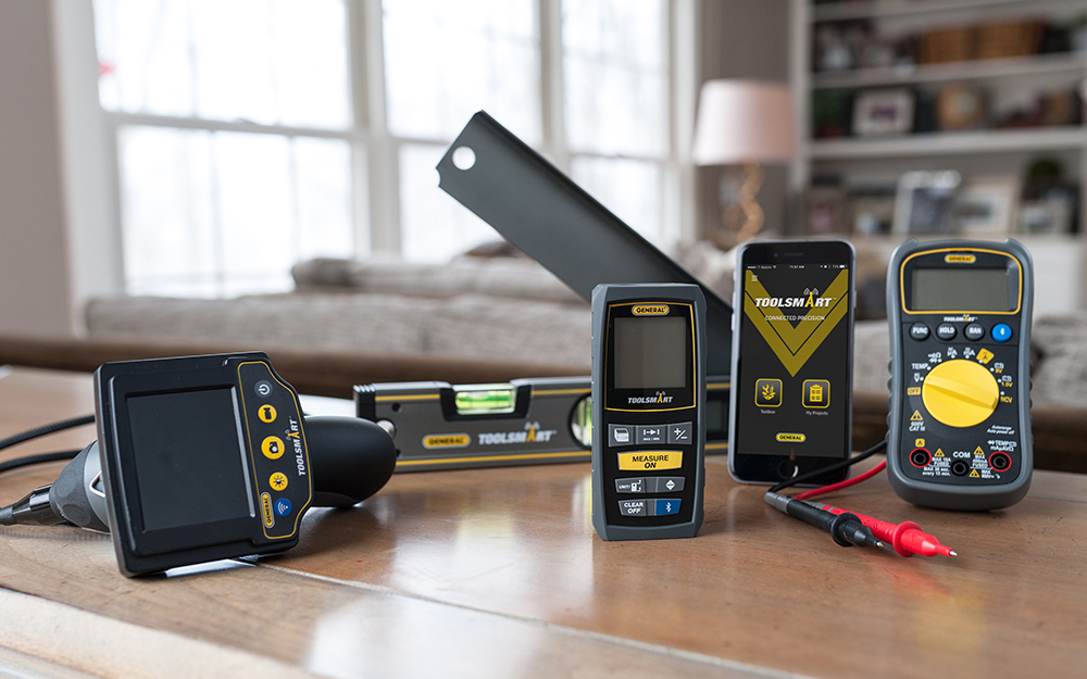 DIfferent types of multimeters on a table