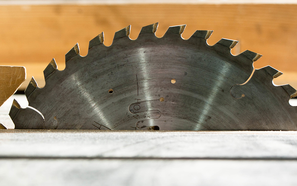 An up close view of a table saw blade.