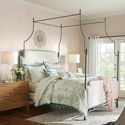 A bedroom with a canopy bed.