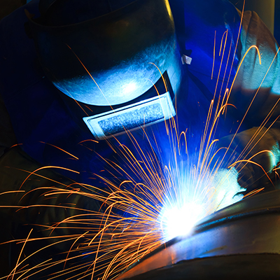 A person welding a piece of metal