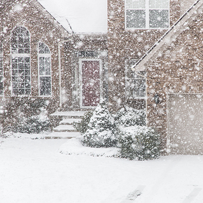 House with snow falling outside.