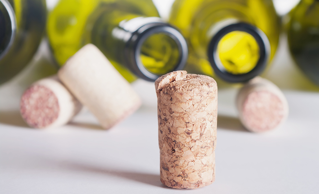 Clean empty wine bottles and corks arranged on a table.