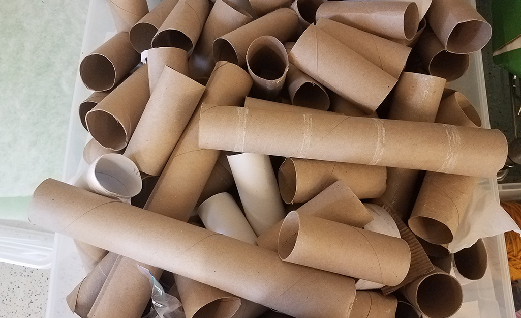 A container of paper tubes from empty rolls of toilet paper and paper towels.