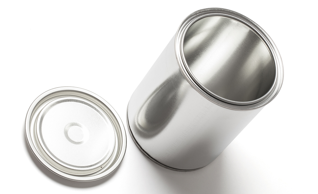 An empty and clean metal paint can and lid.