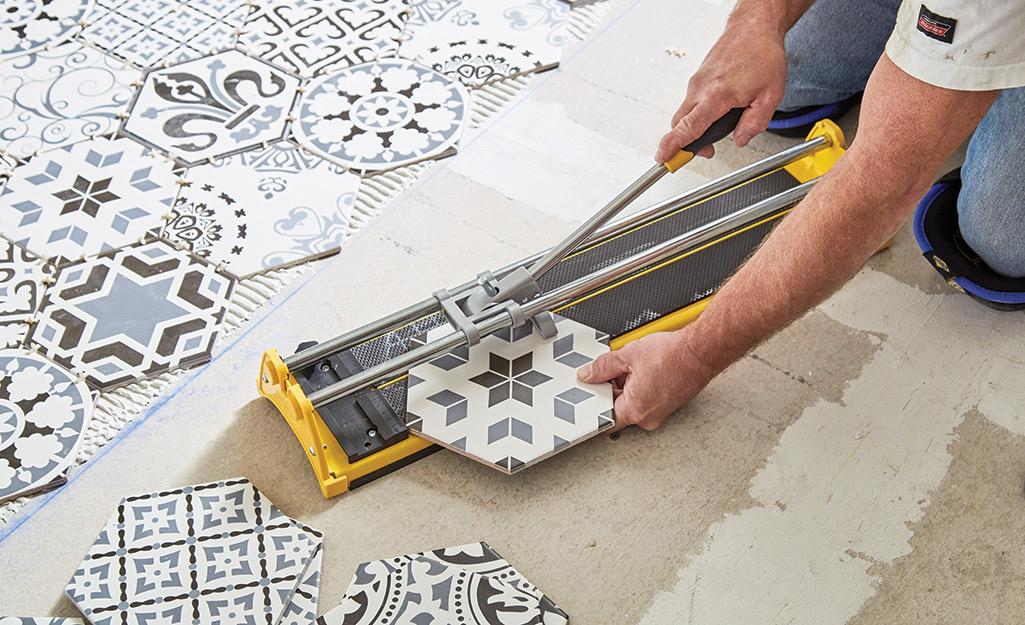 Man cutting tile.