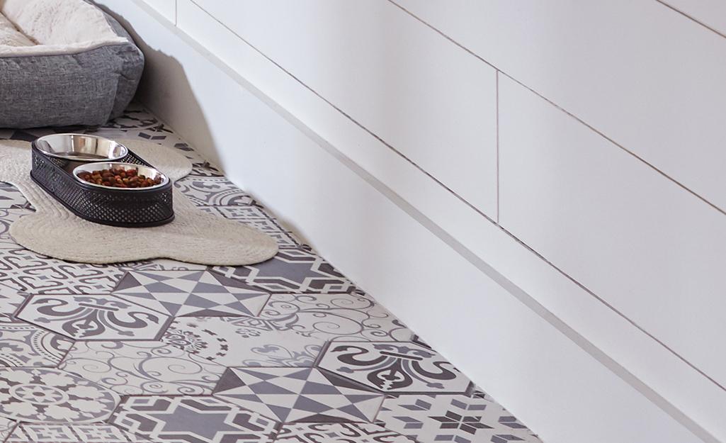 Dog bowl resting on finished tile floor.
