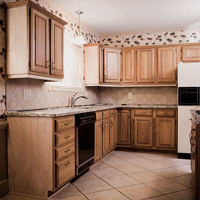 A kitchen with dated cabinets