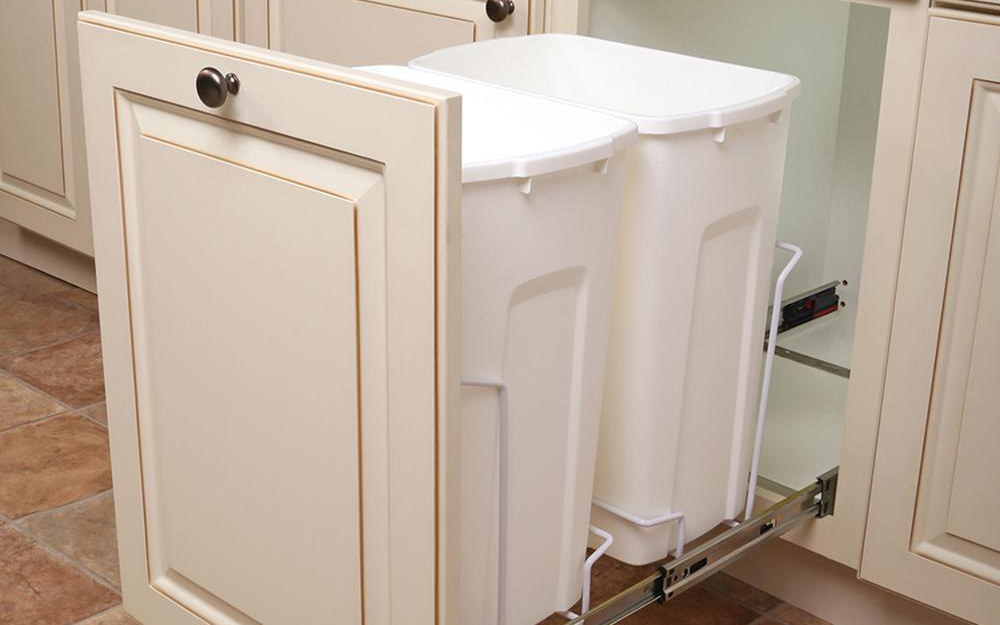 A pull-out trash can cabinet