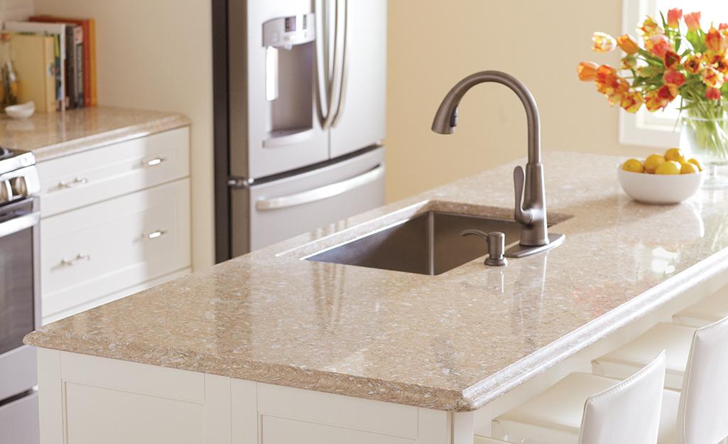 A kitchen with a quartz countertop.