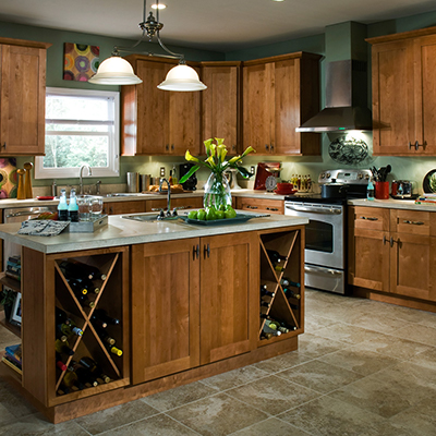 A traditional kitchen with wood cabinets and laminate countertops.