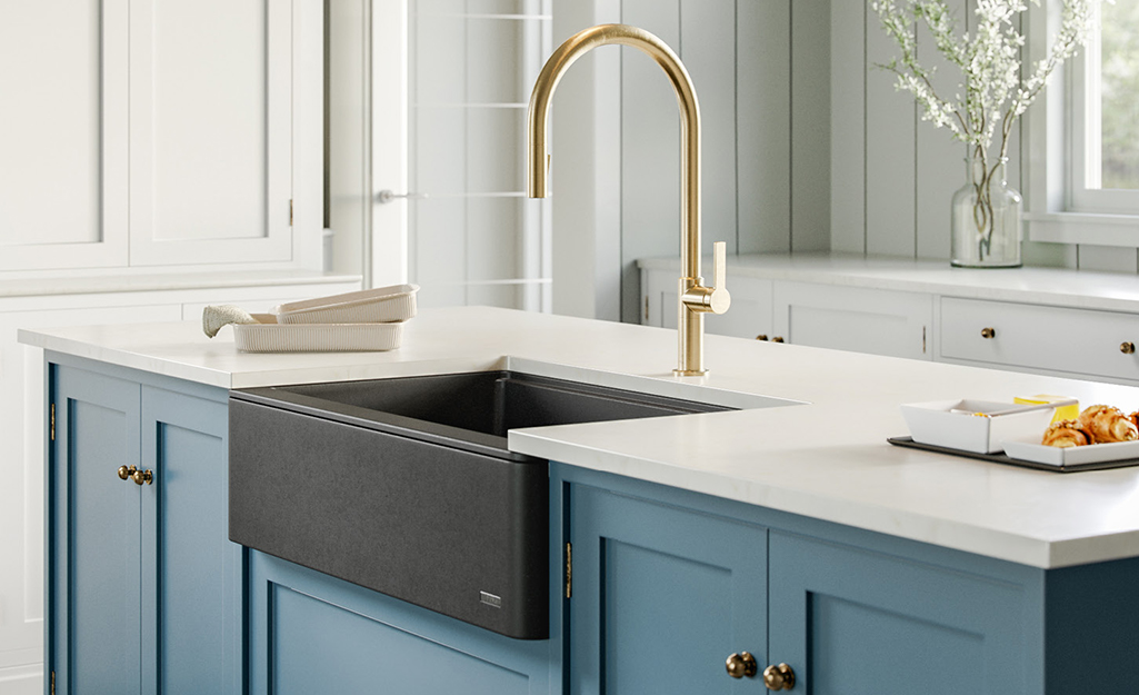 A single bowl kitchen sink with a cutting board in a white countertop.