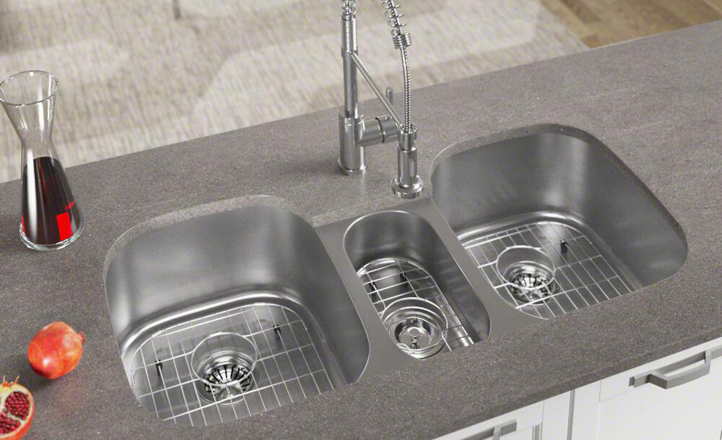 A triple bowl stainless steel kitchen sink.