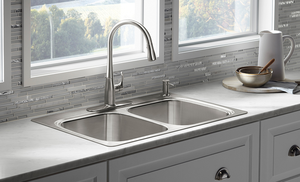Single Bowl Sink With Stone Countertop And Stainless Steel Fixtures