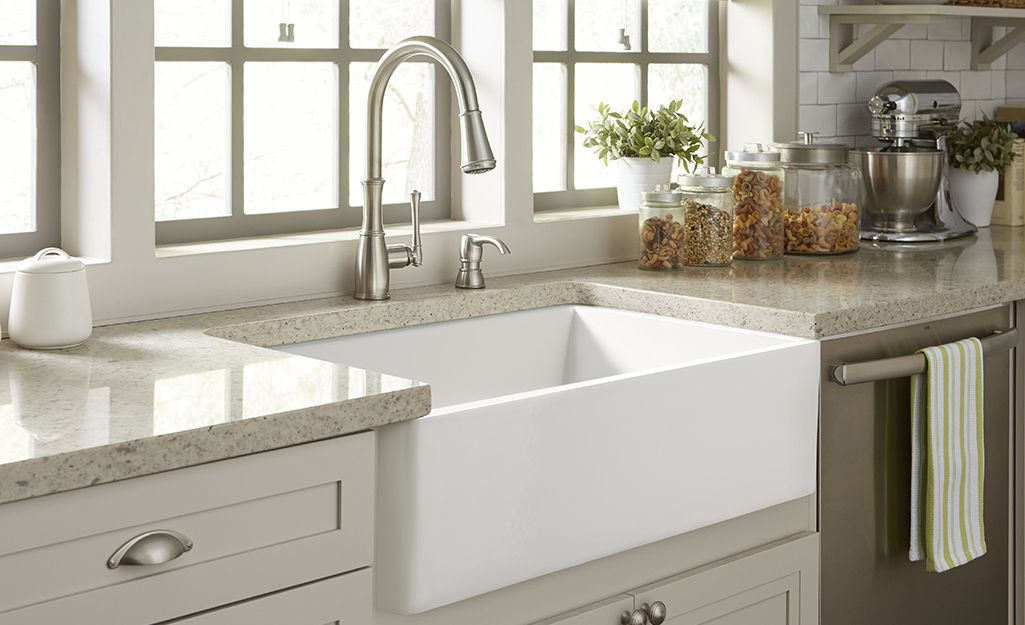 A triple bowl stainless steel sink provides plenty of wash and prep space