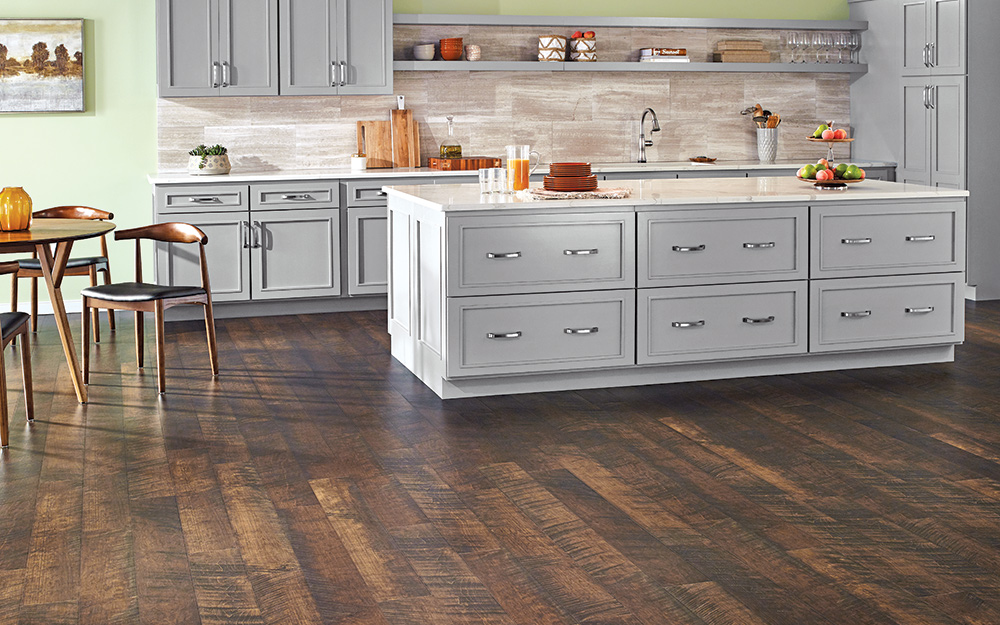 A kitchen with wood-look laminate flooring.