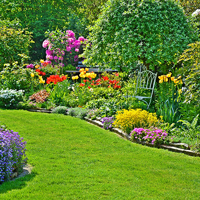 Yard with plastic landscape edging to separate flower beds from lawn