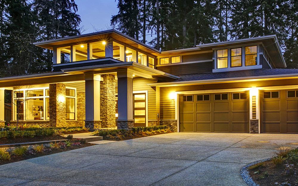 landscape lighting illuminating a driveway