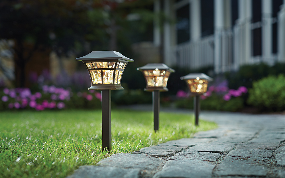 landscape lighting illuminating a walkway