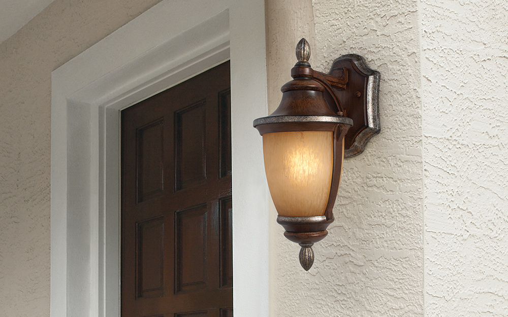 a wall sconce on the exterior of a house