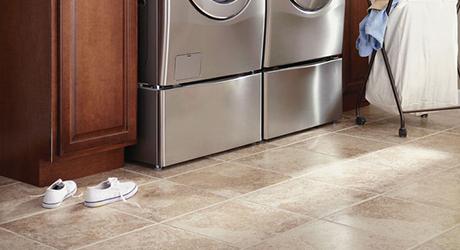 Upgrade flooring and backsplash - Freshen Laundry Room Makeover