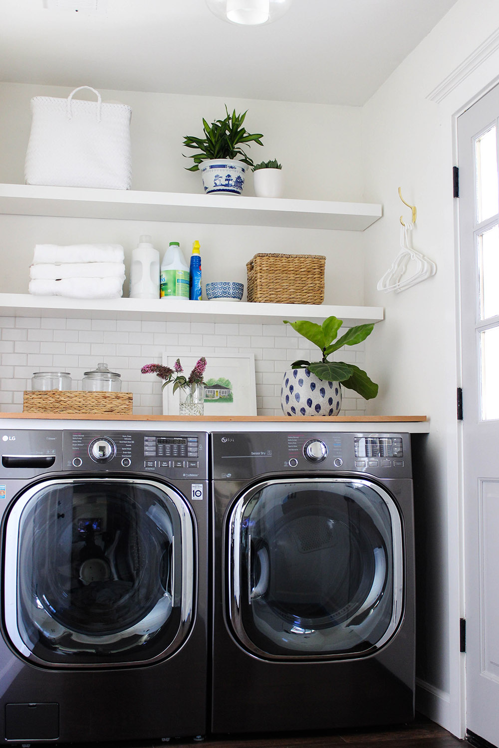 A laundry room with a new LG front load washing machine and dryer.