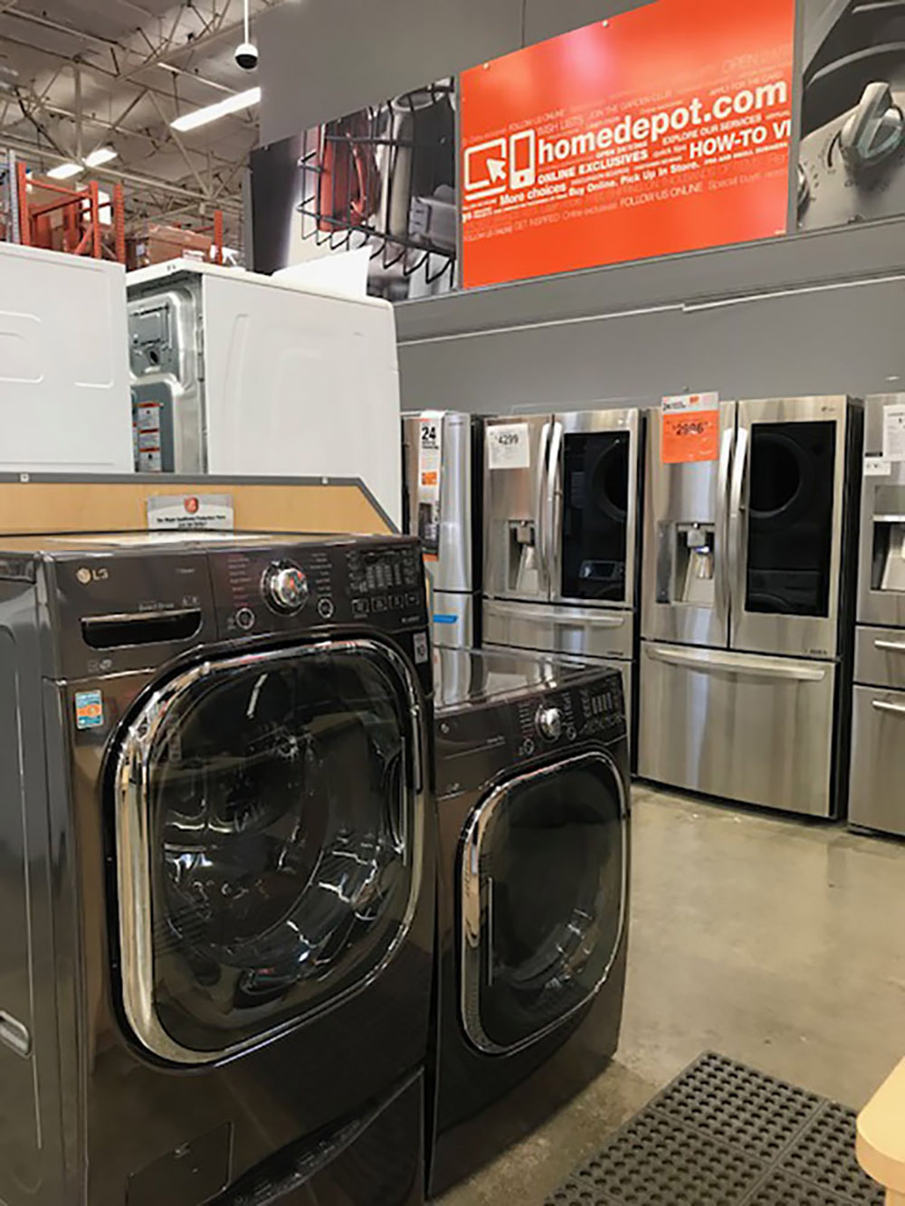 A front load washer and dryer inside The Home Depot store.