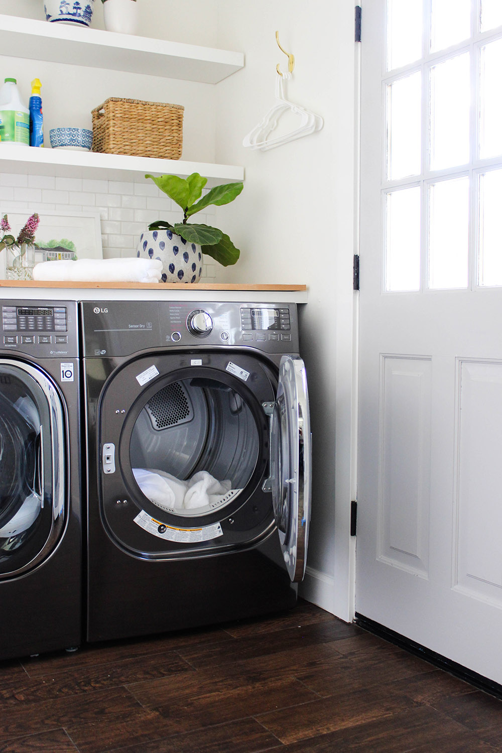 A black LG front load dryer with its door open.