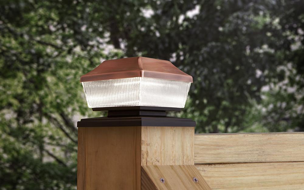 a close up of a post light on a deck