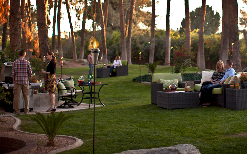 a large backyard illuminated by a variety of different lights