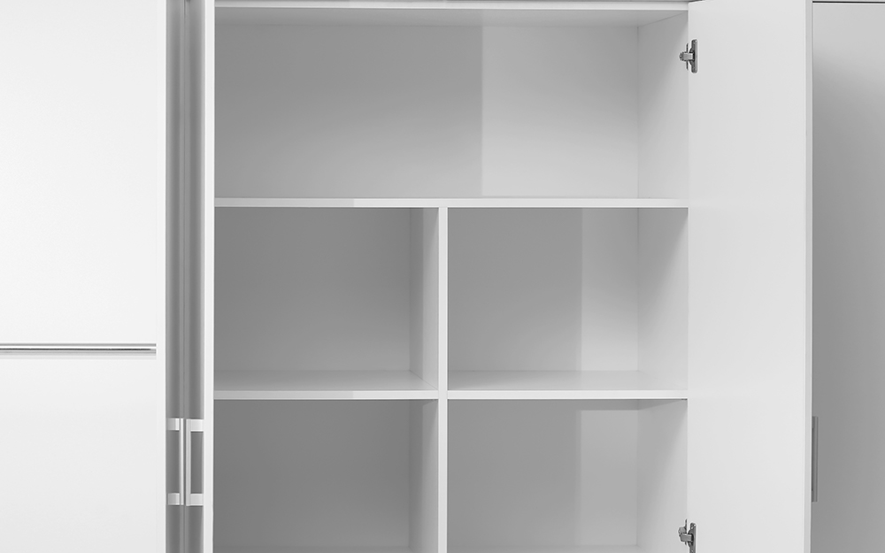 A closet with empty shelves and cubbies