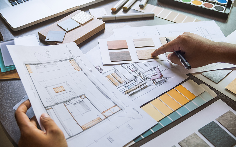 A person looking a interior design plans.