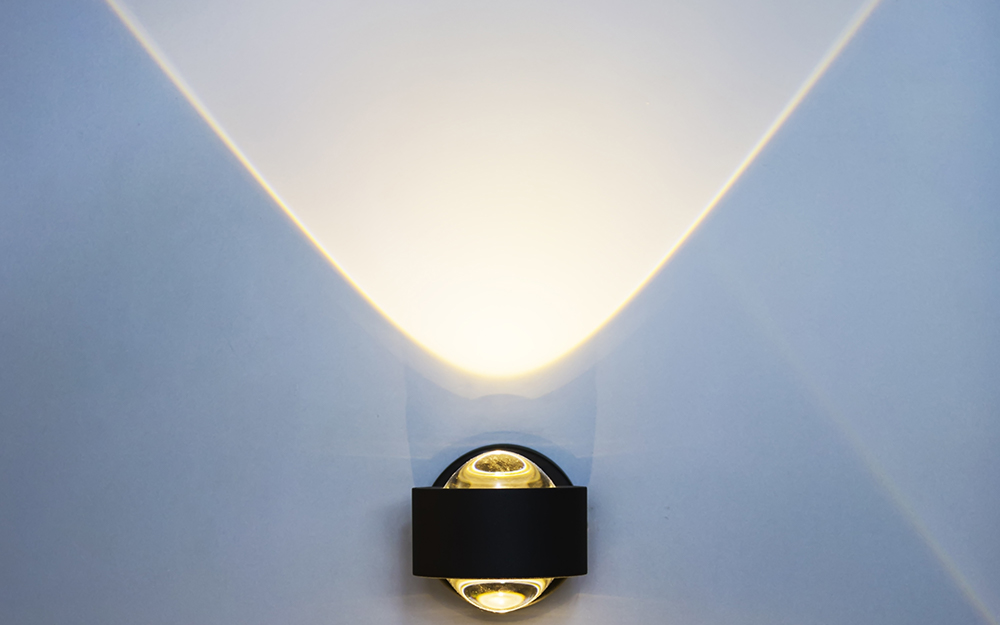 A light beam on a wall from a light bulb