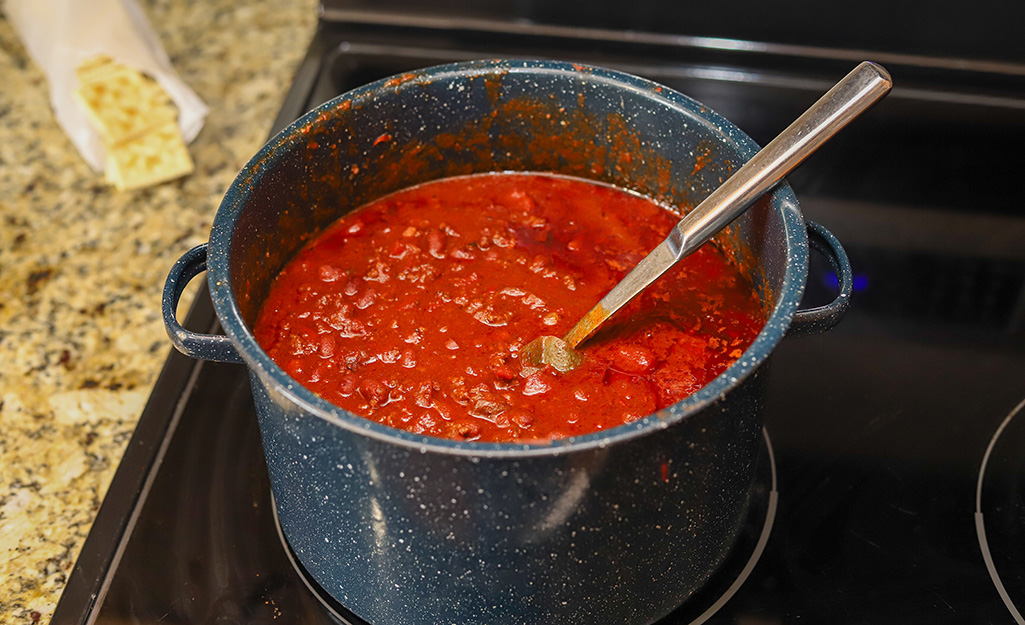 Chili cooking on a stovetop.