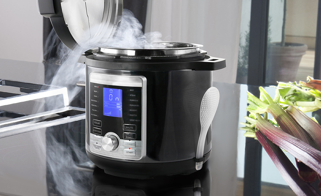 An pressure cooker being used to make food.