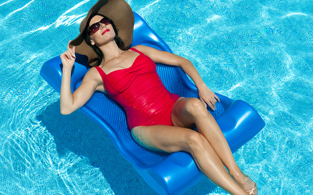 Woman lounging on pool float.