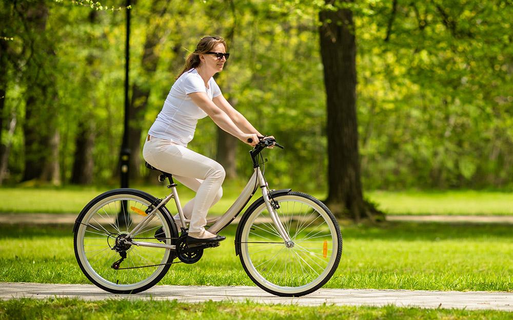 Woman riding a bike.