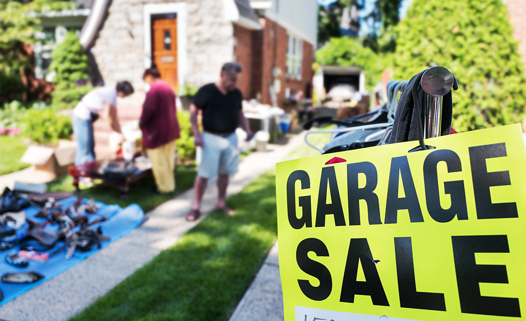 People host a garage sale in their front yard.