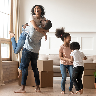 A family dancing in their new house.