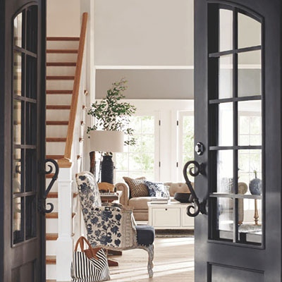 A front door open looking into the entrance of a new home.