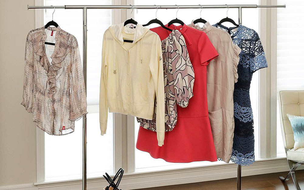 Clothes hanging on a wardrobe rack