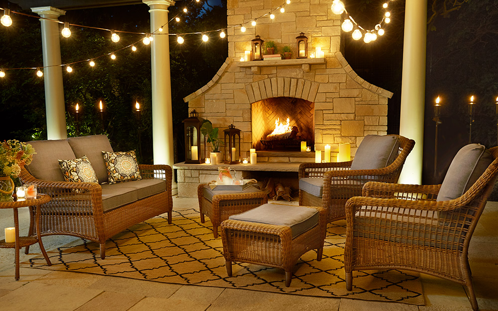 Outdoor patio covered in decorative lighting.