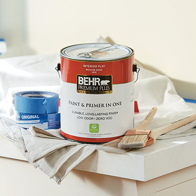 Behr paint surrounded by painting tools.