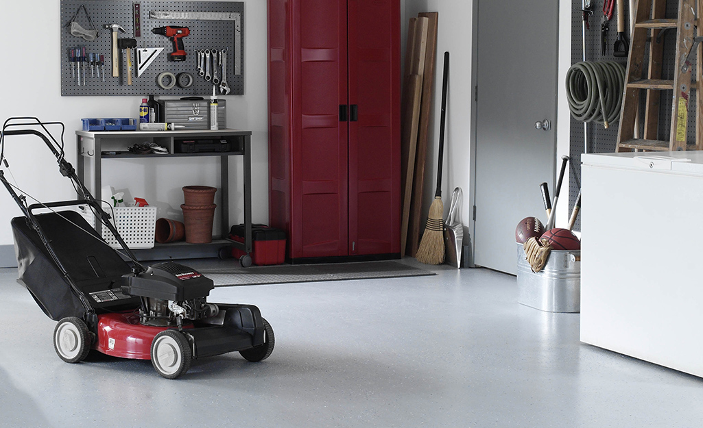A workshop with a pristine, epoxy painted floor.