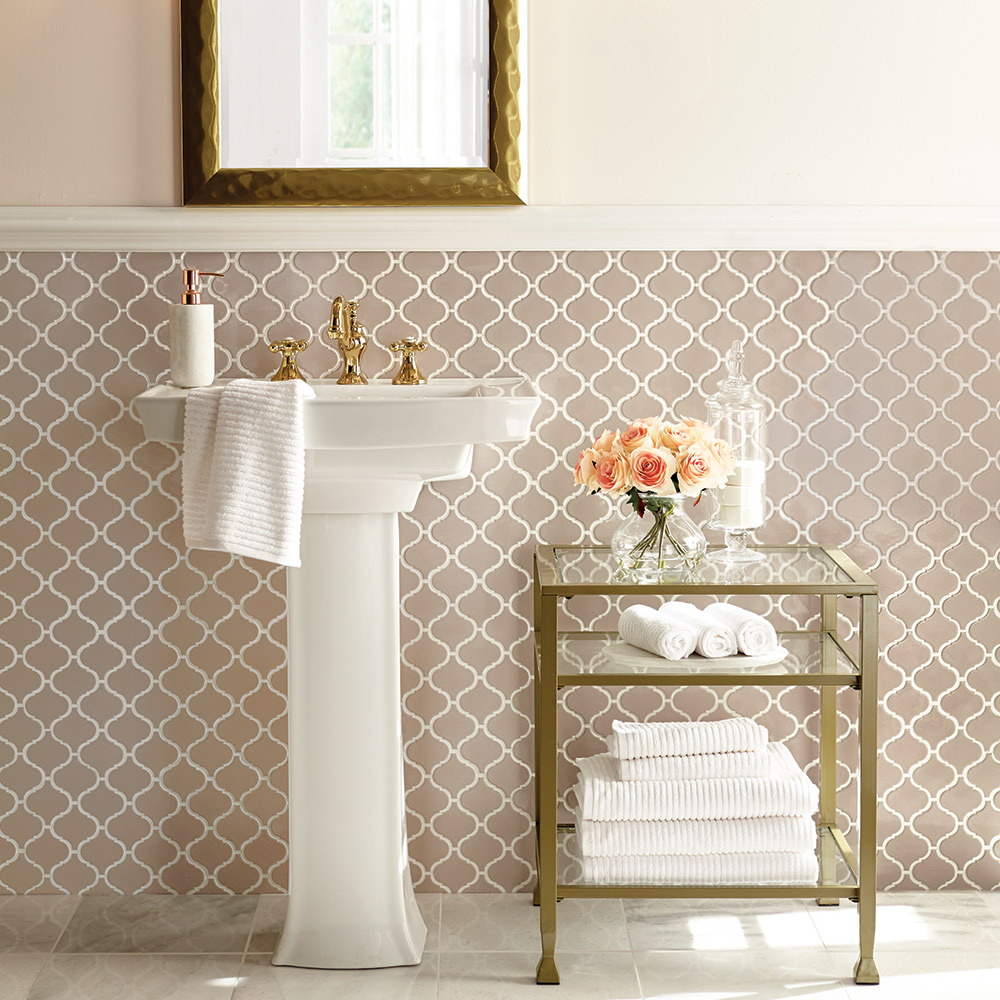 a pedestal sink on a wall in a bathroom