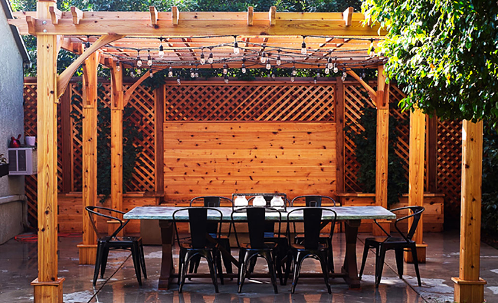 Pergola with long table and chairs for dining.