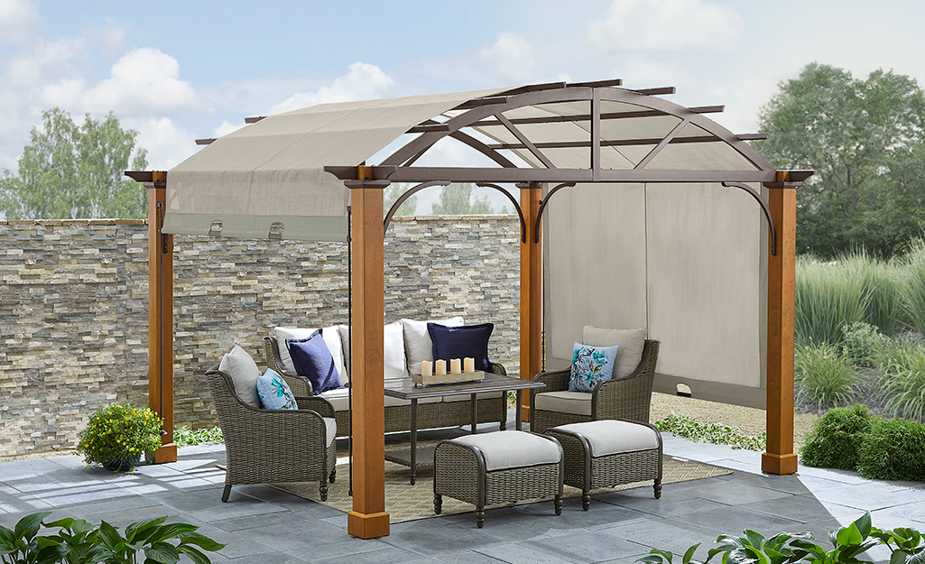 Pergola with adjustable shade canopy.