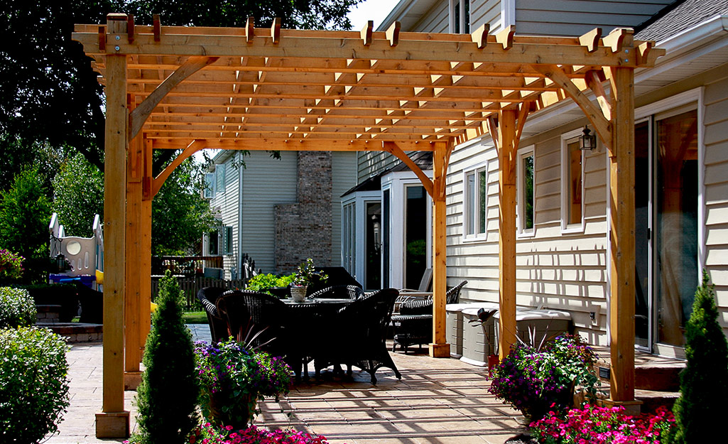Pergola on the back patio provides shade and a space for entertaining.
